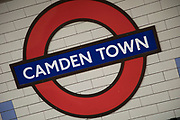Tube sign at Camden Town underground station, London, England, United Kingdom. Camden Town is famed for its market, warren of fashion and shops, and is a haven of alternative counter culture.