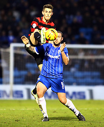 Peterborough United's Shaun Brisley battles with Gillingham's Danny Kedwell - Photo mandatory by-line: Joe Dent/JMP - Tel: Mobile: 07966 386802 14/12/2013 - SPORT - Football - Gillingham - Priestfield Stadium - Gillingham v Peterborough United - Sky Bet League One