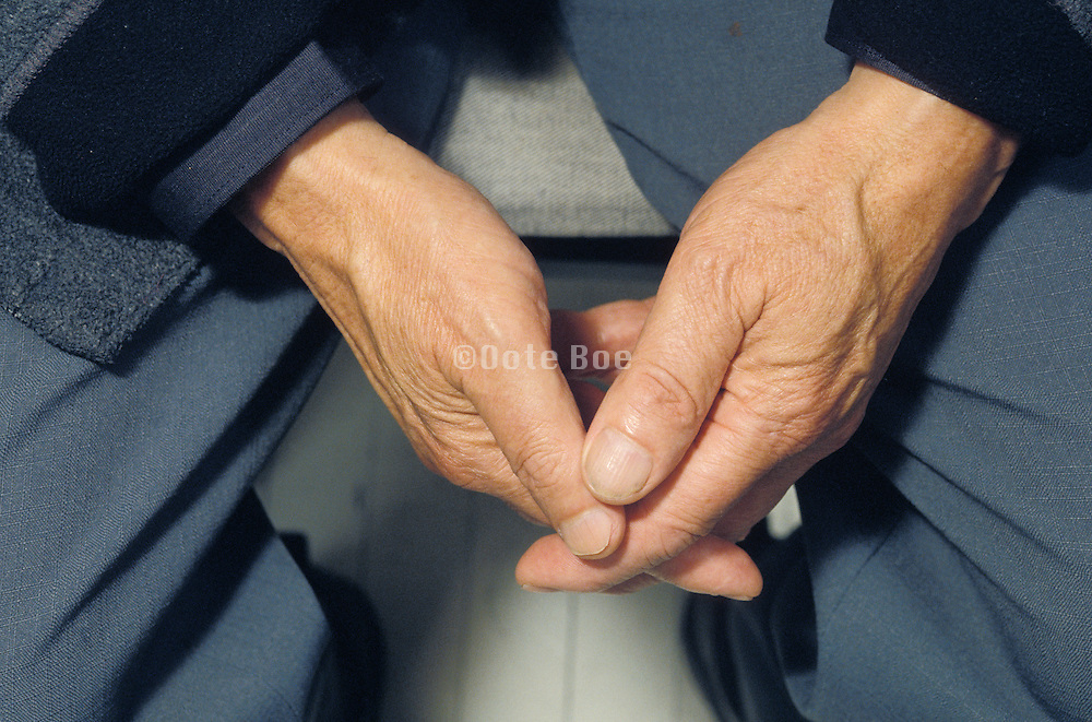 close up of man?s clasped hands