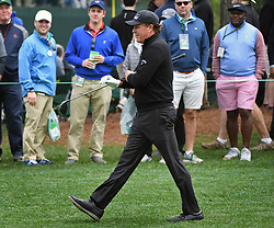 April 6, 2017 - Augusta, GA, USA - Phil Mickelson walks past the gallery along the 15th fairway during first round action of the 2017 Masters Tournament at Augusta National Golf Club on Thursday, April 6, 2017 in Augusta, Ga. Mickelson finished the round at -1. (Credit Image: © Jeff Siner/TNS via ZUMA Wire)
