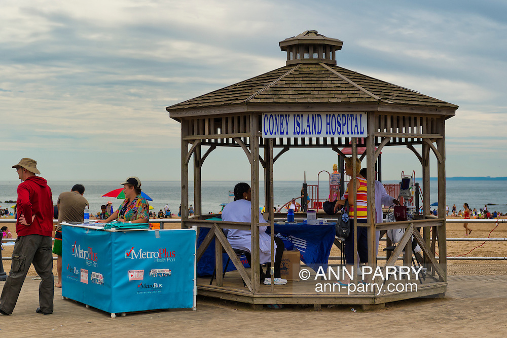 Brooklyn, New York, USA. 10th August 2013. A small Coney Island Hospital is set up in a gazebo on the boardwalk along the beach, during the 3rd Annual Coney Island History Day celebration.