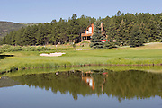 Duck pond and clubhouse at Valle Escondido Taos Canyon Golf Course