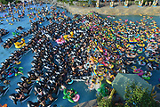 FUSHUN, CHINA - JULY 30: <br /> <br /> People play with inflatable rings and toys at a water park to avoid summer heat on July 30, 2017 in Fushun, Liaoning Province of China. As the temperature reached 32 degrees Celsius in Fushun, people enjoyed themselves in the water park on Sunday. <br /> ©Exclusivepix Media
