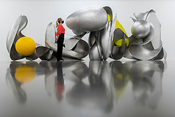 """© Licensed to London News Pictures. 07/07/2021. LONDON, UK. A staff member views """"Dimension"""", 2021, by Liu Wei. Preview of 'Nudità', the biggest exhibition in the UK to date by Beijing-based artist Liu Wei.  New large-scale installations, sculptures and paintings made in response to the global pandemic are on display at White Cube, Bermondsey, 9 July to 5 September 2021.  Photo credit: Stephen Chung/LNP"""