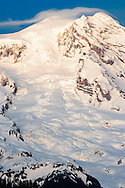 Tahoma Glacier flowing down from the summit of Mount Rainier in winter also showing two of the mountain's summits, Columbia Crest and Point Success., Mount Rainier National Park, WA, USA.