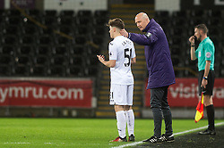 SWANSEA, WALES - Tuesday, January 10, 2017: Swansea City's Manager Cameron Toshack comforts Daniel James after Wolverhampton Wanderers score first goal, during the Football League Trophy 3rd Round match at the Liberty Stadium. (Pic by Gwenno Davies/Propaganda)