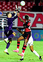 SAO PAULO, BRAZIL - FEBRUARY 25: Tiago Volpi of Sao Paulo FC competes for the ball with Bruno Henrique of CR Flamengo ,during the Brasileirao Serie A 2020 match between Sao Paulo FC and CR Flamengo at Morumbi Stadium on February 25, 2021 in Sao Paulo, Brazil. (Photo by MB Media/BPA)