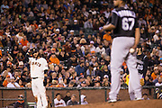 San Francisco Giants shortstop Brandon Crawford (35) reacts to hitting a triple against Colorado Rockies relief pitcher German Marquez (67) at AT&T Park in San Francisco, Calif., on September 27, 2016. (Stan Olszewski/Special to S.F. Examiner)
