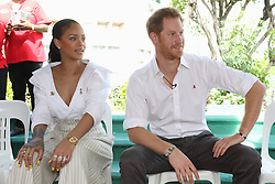Rihanna and Prince Harry take part in a live HIV test, at the 'Man Aware' event held by the Barbados National HIV/AIDS Commission in Bridgetown, Barbados, during his tour of the Caribbean.