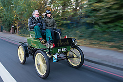 EDITORIAL USE ONLY Jodie Kidd and James Healy, Harrods' Director of Store Operations, drive the Harrods 1901 veteran Pope Waverley electric car through London during the Bonhams London to Brighton Veteran Car Run.