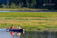 Family canoeing on Upper Stillwater Lake in Montana model released