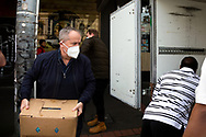 Bill Shorten (left) is seen helping load much needed halal meat into a truck bound for the residents of the locked down housing commission towers during COVID-19 on 10 July, 2020 in Melbourne, Australia. Former Federal Labor Leader Bill Shorten, along with close allies at Trades Hall help deliver Halal meat, supplied by Macca Halal Foods to the locked down housing commission towers following a coronavirus outbreak detected inside the complex. Mr Shorten was able to use his high profile to ensure food was not turned away by police so that it would reach the residents inside. (Photo be Dave Hewison/ Speed Media)