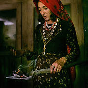 "The head woman of the household, named Samarkand, bless the house with burning ""Spandr"", a local herb - a Pamiri tradition.  The festivities around the muslim celebration of Eid-e Qurban (the holiday of Sacrifice). The traditional life of the Wakhi people, in the Wakhan corridor, amongst the Pamir mountains."