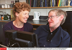 Liibrary picture taken in October 2001 of Professor Stephen Hawking and his wife Elaine Mason at his office in Cambridge, UK. Police investigating alleged assaults on disabled scientist Stephen Hawking said on Monday March 29, 2004 there was no evidence to substantiate the claims. Photo by Ammar Abd Rabbo/ABACA    57883_02