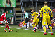 AFC Wimbledon midfielder Alex Woodyard (4) passing the ball to AFC Wimbledon striker Joe Pigott (39) during the EFL Sky Bet League 1 match between Charlton Athletic and AFC Wimbledon at The Valley, London, England on 12 December 2020.