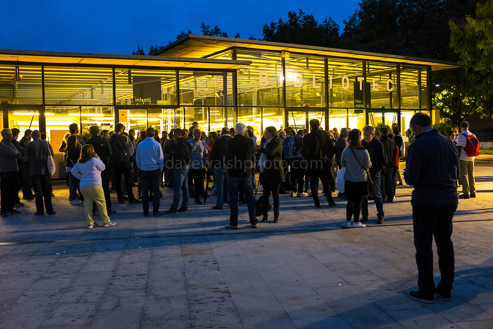 Catalans waiting to vote at Biblioteca Central Gabriel Ferrater, Sant Cugat del Valles, just outside Barcelona, Catalonia, so that they can vote in the Catalan Independence Referendum. People had spend the night guarding the voting stations so that they were not seized by police.