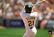 OAKLAND - 1993:  Ruben Sierra of the Oakland Athletics bats during an MLB game at the Oakland Coliseum in Oakland, California during the 1993 season. (Photo by Ron Vesely) Subject:   Ruben Sierra