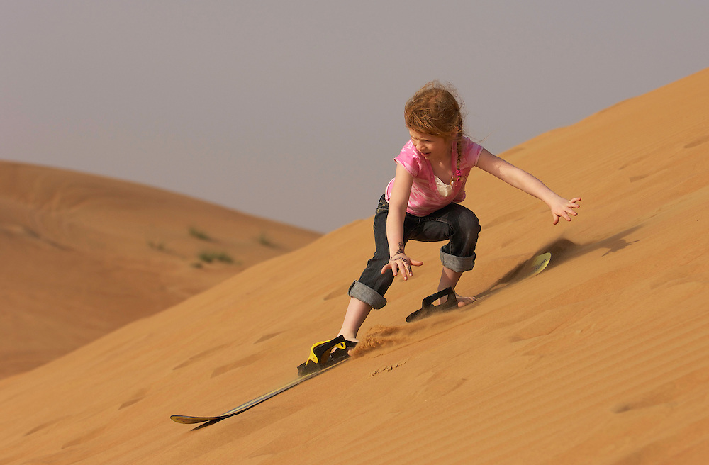 "tourist Mimmi Widstrand, ""Sand boarding"" on a sand dune, Dubai"