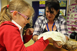Art teacher showing visually impaired girl large shell to feel. Mysight Nottinghm