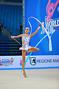 Kabrits Laurabell during qualifying at ribbon in Pesaro World Cup 11 April 2015. Laurabell is an Estonian rhythmic gymnastics athlete born on March 3 ,1999 in Tallinn, Estonia.