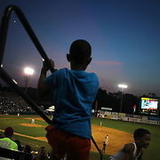 Young spectators watch while hanging on the railings in the stand during the New Britain Rock Cats Vs Binghamton Mets Minor League Baseball game at New Britain Stadium, New Britain, Connecticut, USA. 2nd July 2014. Photo Tim Clayton