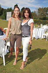 Left to right, GEORGINA RYLANCE and CEILA WISE at a cricket match to in aid of CARE - Corfu Animal Rescue Establishment held at Hawkley Cricket Club, Hawkley, Hampshire on 8th September 2012.