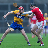 Clare's Niall Deasy is tackled by Cork's Robert Downey