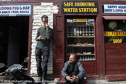 Corey Froschheuser and Kiwi Mike Tomas on a chai break at the Buddha Pub and Bar in Marpha on day-5  of our Himalayan Heroes adventure riding from Kalopani through the Mustang District to our highest elevation of the trip at over 12,000' when we reached Muktinath, Nepal. Saturday, November 10, 2018. Photography ©2018 Michael Lichter.