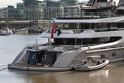 © Licensed to London News Pictures. 01/10/2016. LONDON, UK.  The dinghy attached to superyacht Kismet. Kismet' arrived in London and moored at Butlers Wharf on the River Thames earlier this week, but the silver Jaguar was not fitted on its arrival. Kismet is 308 feet long and is reportedly owned by Pakistani-American billionaire Shahid Khan. Mr Khan owns the National Football League (NFL) team, the Jacksonville Jaguars, who are due to play the Colts in an International Series game at Wembley tomorrow. Kismet has 6 staterooms, with the master bedroom having its own private deck with jacuzzi and helipad and can be chartered for an estimated £1m per week.  Photo credit: Vickie Flores/LNP
