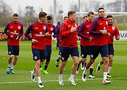 England's John Stones, Ross Barkley and Chris Smalling warm up with the squad  - Mandatory byline: Matt McNulty/JMP - 22/03/2016 - FOOTBALL - St George's Park - Burton Upon Trent, England - Germany v England - International Friendly - England Training and Press Conference