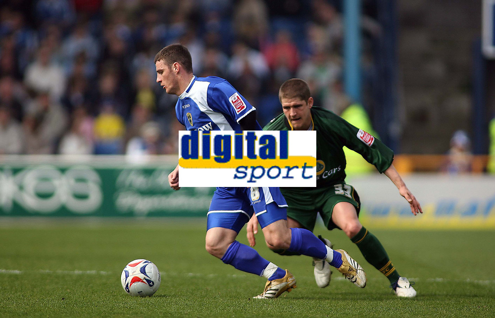Jason Koumas with ball for Cardiff City trys to get past Carl Robinson