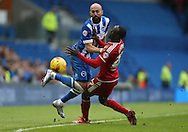 Brighton defender, Bruno Saltor (2) tackled by Middlesbrough FC midfielder Albert Adomahduring the Sky Bet Championship match between Brighton and Hove Albion and Middlesbrough at the American Express Community Stadium, Brighton and Hove, England on 19 December 2015.