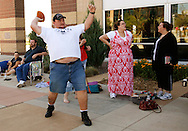 """Josh Haigh throws a football as he waits in line for an open casting call for season 11 of """"The Biggest Loser"""" television show in Broomfield, Colorado July 17, 2010. Over 60o people vied for a chance to be on the show and win $250,000.   REUTERS/Rick Wilking (UNITED STATES)"""