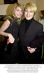 Musician NICK RHODES and MISS MEREDITH OSTROM at an exhibition in London on 20th November 2001.OUI 112.