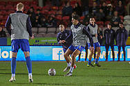AFC Wimbledon defender Will Nightingale (5) and AFC Wimbledon midfielder Mitchell (Mitch) Pinnock (11) warming up during the The FA Cup match between AFC Wimbledon and West Ham United at the Cherry Red Records Stadium, Kingston, England on 26 January 2019.