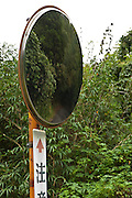 Relection from a mirror provides a glimpse around the corner and down narrow road near Narita, Japan.