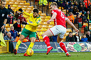 Norwich City striker Nelson Oliveira (9) crosses the ball Barnsley defender Liam Lindsay (6) defending during the EFL Sky Bet Championship match between Norwich City and Barnsley at Carrow Road, Norwich, England on 18 November 2017. Photo by Phil Chaplin.