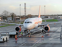 Easyjet Airbus A320 on the tarmac at Belfast International Airport 5th December 2014. 201412050115<br /> <br /> Copyright Image from Victor Patterson, 54 Dorchester Park, Belfast, UK, BT9 6RJ<br /> <br /> t: +44 28 9066 1296<br /> m: +44 7802 353836<br /> vm +44 20 8816 7153<br /> <br /> e1: victorpatterson@me.com<br /> e2: victorpatterson@gmail.com<br /> <br /> www.victorpatterson.com<br /> <br /> IMPORTANT: Please see my Terms and Conditions of Use at www.victorpatterson.com