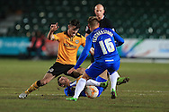 Andrew Hughes of Newport county looks to go past Nicky Featherstone of Hartlepool (16). Skybet football league two match, Newport county v Hartlepool Utd at Rodney Parade in Newport, South Wales on Tuesday 15th March 2016.<br /> pic by Andrew Orchard, Andrew Orchard sports photography.