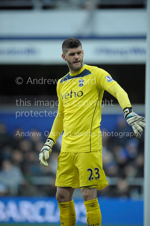 Goalkeeper Fraser Forster of Southampton punching the goal post. Barclays Premier league match, Queens Park Rangers v Southampton at Loftus Road in London on Saturday 7th Feb 2015. pic by John Patrick Fletcher, Andrew Orchard sports photography.