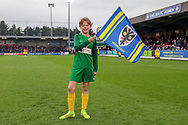 AFC Wimbledon fan waving flag during the EFL Sky Bet League 1 match between AFC Wimbledon and Accrington Stanley at the Cherry Red Records Stadium, Kingston, England on 6 April 2019.