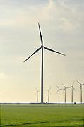 Nederland, Eemshaven, 15-4-2015 In het havengebied in noord groningen staan ruim 90 windturbines waarvan de meesten van RWE. Ook een traditionele ouderwetse klassieke molen staat in het landschap hetgeen een mooi contrast geeft met de moderne versie. FOTO: FLIP FRANSSEN/