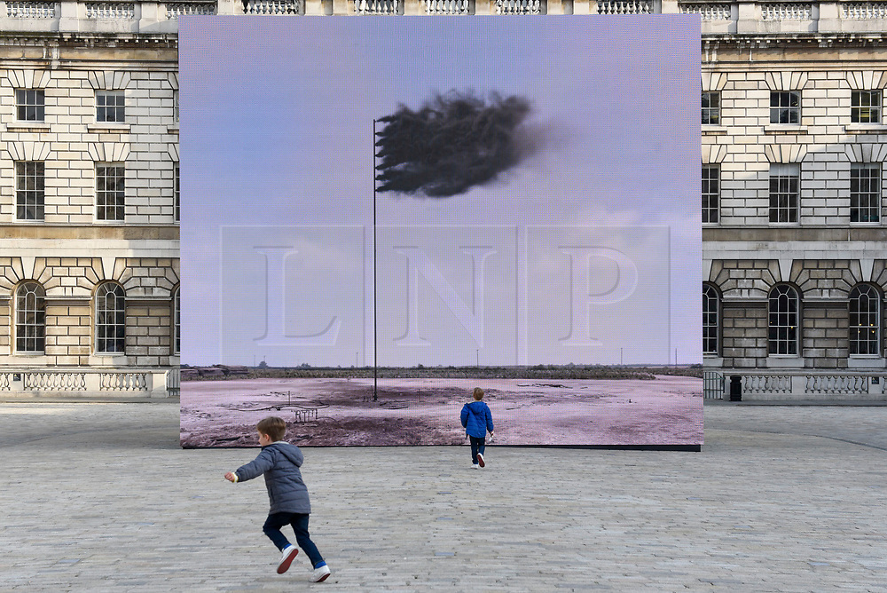 """© Licensed to London News Pictures. 20/04/2017. London, UK. Unveiling at Somerset House of """"Western Flag"""" (Spindletop, Texas) 2017 by artist John Gerrard.  The artwork, in the form of an LED wall installation, is a symbol for climate change and modern society's dependence on oil and has been commissioned by Channel 4 as part of their Man-Made Planet season to mark this year's Earth Day (22nd April).   Photo credit : Stephen Chung/LNP"""
