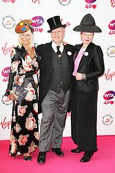 © Licensed to London News. Virginia Bates; Stephen Jones, Pre-Wimbledon Party, Kensington Roof Gardens, London UK, 20 June 2013. Photo credit : Richard Goldschmidt/Piqtured/LNP