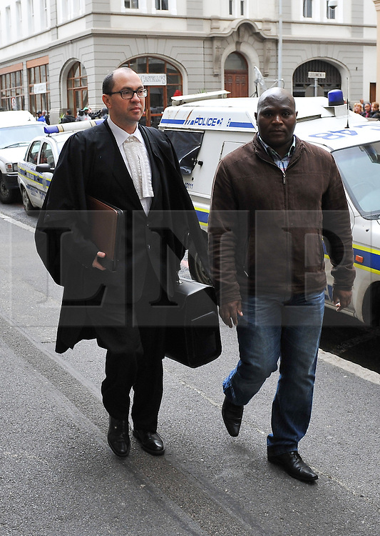 © Licensed to London News Pictures. 08/10/14. CAPE TOWN, SOUTH AFRICA -   State prosecutor, Advocate Adrian Mopp, arrives at court during Day 3 of the Shrien Dewani trial at the Cape High Court before Judge Jeanette Traverso. Dewani is caused of hiring hit men to murder his wife, Anni. Anni Ninna Dewani (née Hindocha; 12 March 1982 – 13 November 2010) was a Swedish woman who, while on her honeymoon in South Africa, was kidnapped and then murdered in Gugulethu township near Cape Town on 13 November 2010. Photo credit : Roger Sedres/LNP