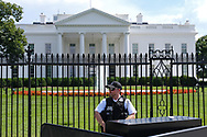 WASHINGTON - JUNE 29, 2019: A secret service agent stands in front of The White House on Pennsylvania Avenue NW on June 29, 2019, in Washington, D.C.