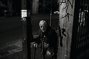 """Athens, Greece - An old lady begging. The Hellenic Statistical Authority in 2012 reported the risk of poverty for people aged 65 year and over was 21.3%. Greek economical crisis started in 2008. The so-called Austerity measures imposed to the country by the """"Troika"""" (European Union, European Central Bank, and International Monetary Fund) to reduce its debt, were followed by a deep recession and the worsening of life conditions for millions of people. Unemployment rate grew from 8.5% in 2008 to 25% in 2012 (source: Hellenic Statistical Authority).<br /> Bruno Simões Castanheira"""