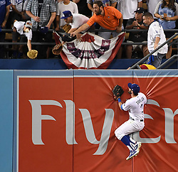 October 25, 2017 - Los Angeles, California, U.S. - Los Angeles Dodgers center fielder Chris Taylor catch reach a solo home run by Houston Astros' Marwin Gonzalez (not pictured) in the ninth inning of game two of a World Series baseball game at Dodger Stadium on Wednesday, Oct. 25, 2017 in Los Angeles. Houston Astros won 7-6 in 11 innings. (Photo by Keith Birmingham, Pasadena Star-News/SCNG) (Credit Image: © San Gabriel Valley Tribune via ZUMA Wire)