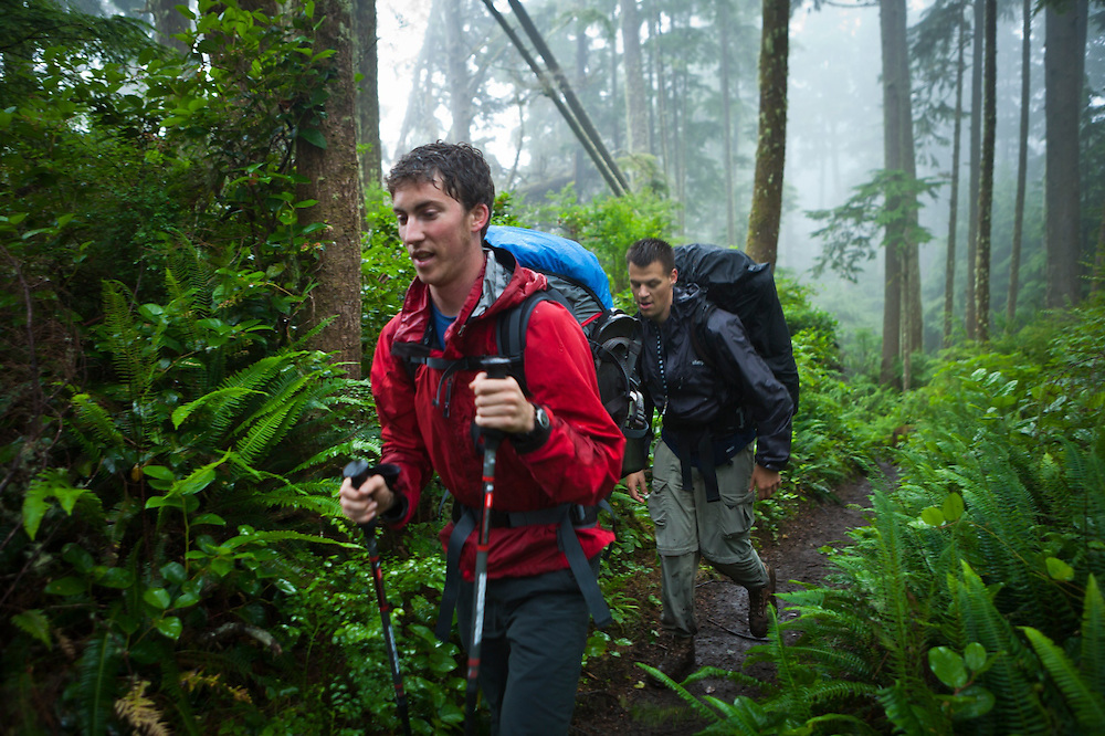 Zach Podell-Eberhardt (left) and Henry hike through a damp, misty forest along the West Coast Trail, British Columbia, Canada.