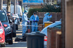 © Licensed to London News Pictures. 22/03/2021. London, UK. Forensic investigators at the scene following a disturbance at a premises in Granville Avenue, Hounslow. Metropolitan Police attended at approximately 03:20GMT and found two men suffering stab injuries. A man, aged in his 20s, was treated at the scene but died at 04:23GMT. The second man, also aged in his 20s, was taken to hospital. His injuries were assessed and he has since been discharged. Photo credit: Peter Manning/LNP